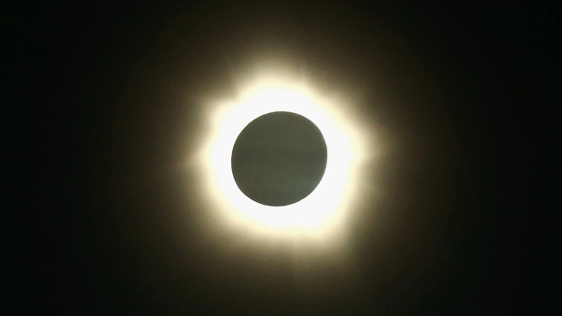 link: http://www.cbc.ca/news/technology/rare-hybrid-solar-eclipse-to-appear-sunday-1.2325257?cmp=fbtl