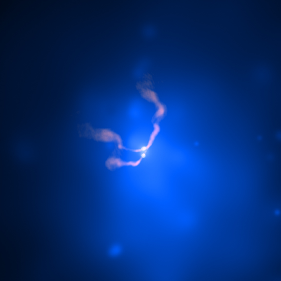 Two co-orbiting black holes at the centers of merging galaxies, photographed in x-ray (blue) and radio (pink) light