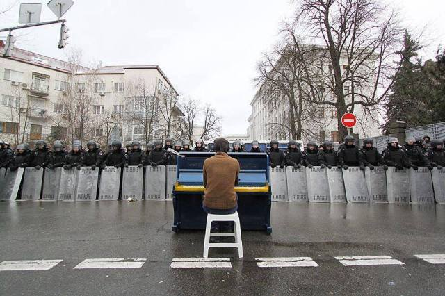 Some challenges I simply do not know. (Above a man in Ukraine faces a wall of riot police.)